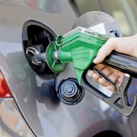 Inflation cools as clothes costs fall but petrol hits eight-year highs