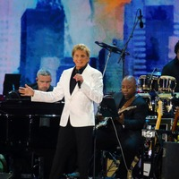 Henri cuts short Barry Manilow set at New York virus recovery concert
