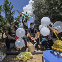 Israel carries out air strikes on Gaza after launch of incendiary balloons