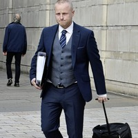 Jamie Bryson fails in a bid to have judge step aside from hearing a challenge to his ongoing prosecution linked to Nama