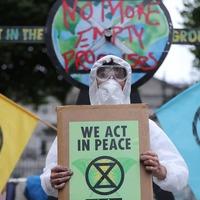 Climate protesters gather in Dublin as Dáil returns