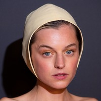 Emma Corrin swaps crown for a bonnet at Emmys red carpet