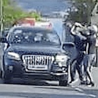Police investigating after car attacked in west Belfast