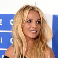 Britney Spears shares saucy pictures while celebrating legal victory on holiday