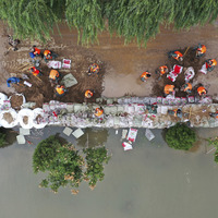 Several missing after deadly bus plunge during Chinese floods