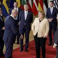 EU leaders give Angela Merkel big send-off